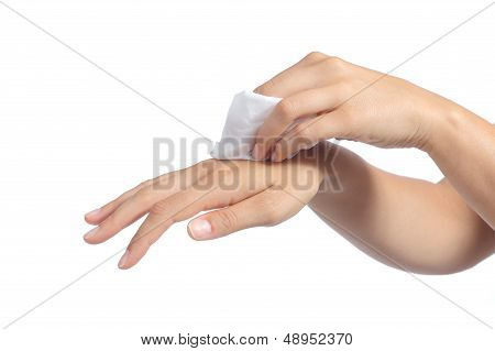 Hands Of A Woman Cleaning With A Baby Wipe