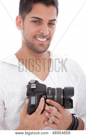 Smiling Man With A Digital Camera