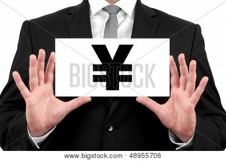 Japanese Yen sign. Businessman shows business card