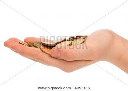 Mão está segurando algumas pequenas moedas de Euro