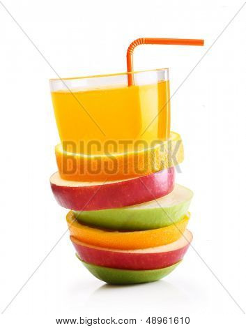 Stack of orange fruit and apples slices with juice.