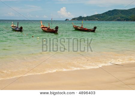 Three Wooden Boats At The Beach