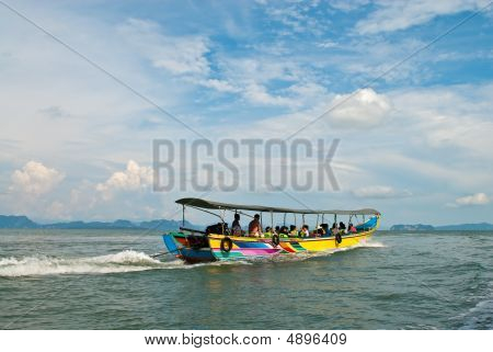 Traditional Thai Tourist Wooden Boat Putting Out To Sea