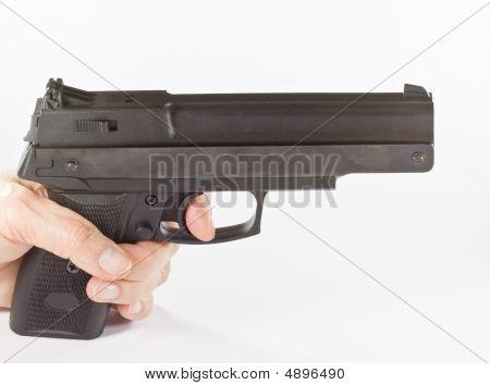 Pistol In Hand On White Background