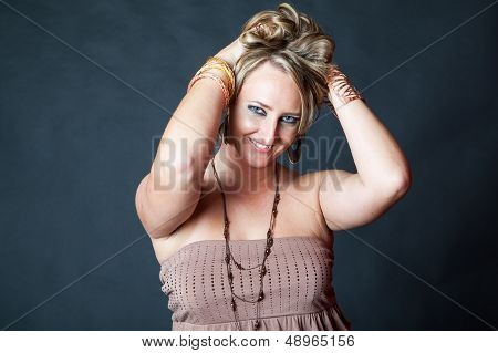 Young Blonde Woman Pushing Her Hair Up