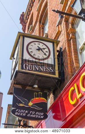 DUBLIN, IRELAND - JUNE 7: Clock with Guinness logo on a building, Dublin, Ireland on June 7, 2013