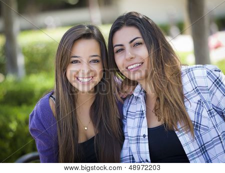 Portrait of Two Attractive Mixed Race Female Friends Outdoors.