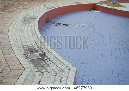 Empty Wet Swimming Pool With Leafs