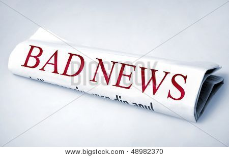 Bad news word on newspaper