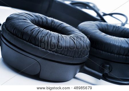 black full size headphones on a white background