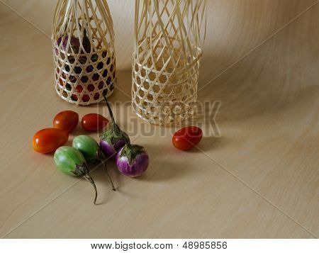 Eggplant And Bamboo Basket