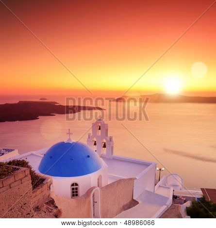 View of a blue dome of the church St. Spirou in Firostefani on the island of Santorini Greece, at sunset