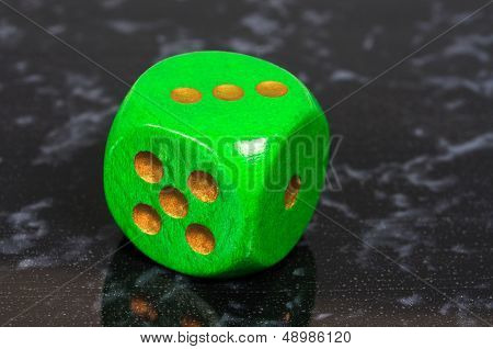 Platonic green six sided dice.
