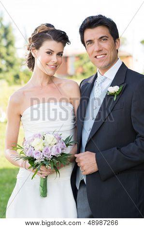 Portrait Of Happy Beautiful Young Married Couple Otdoor