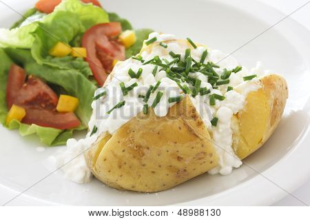 baked potato with cottage cheese chives and fresh salad