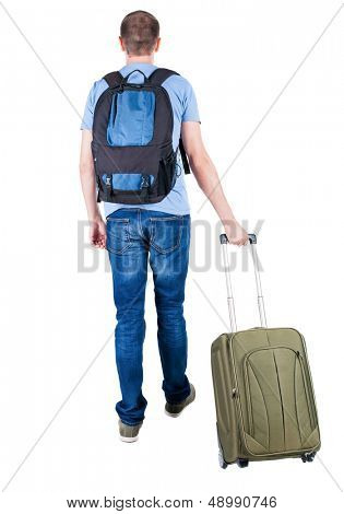 back view of walking  man  with suitcase.   backside view of person.  Rear view people collection. Isolated over white background. young man goes to side of a rolling travel bag on wheels