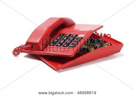 Red Telephone Exposing Internal Components On White Background