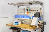 foto of pegboard  - Technician workbench desk with tools and shelves - JPG
