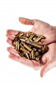 image of 9mm  - a heap of 9mm pistol bullets holded by human hands isolated over a white backgrounds