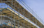 stock photo of scaffolding  - scaffolding on a building under construction in the netherlands - JPG