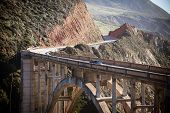 foto of pch  - A view of Bixby Bridge out to the Pacific Ocean near Big Sur California USA - JPG