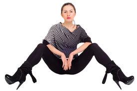 stock photo of debauchery  - Sexy girl posing with his legs apart - JPG