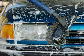 picture of car wash  - Foamy front of a blue car being cleaned - JPG
