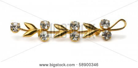 Golden floral brooch isolated on white