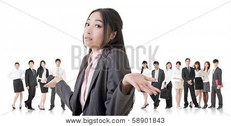 Attractive Asian business woman give you a helpless sign and stand in front of her team.