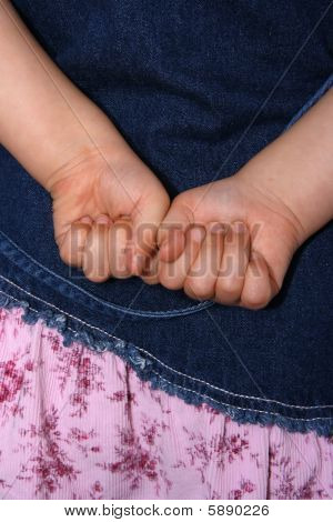 Childs Hands Clenched