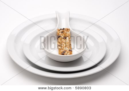 Colorful Granola Bar On Bland White Serving Dishes