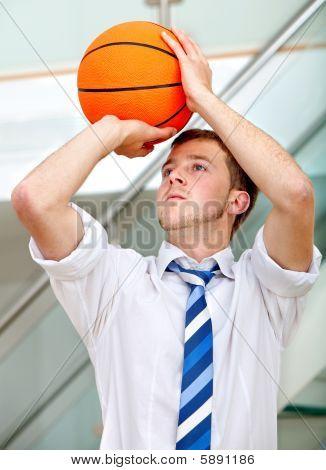 Business Man Throwing A Basketball