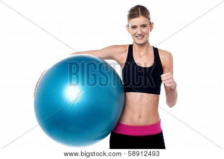 Fitness Girl With Aerobic Ball  Showing Thumbs Sign