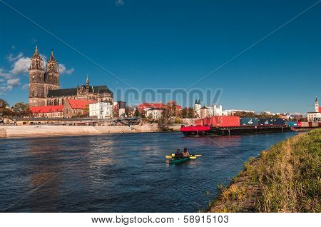 Cathedral Of Magdeburg At River Elbe, Barge And Canoeing