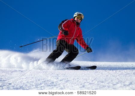 Man Skiing On Ski Slope