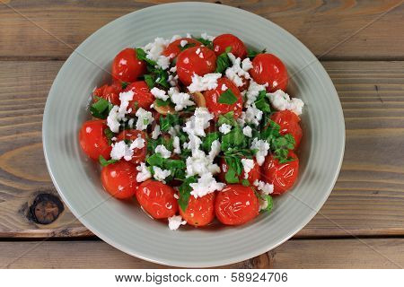 Fried Mini Tomatoes And Seasonings, Seasoned With Parsley And Feta Cheese