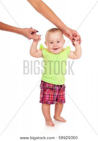 Smiling child walking hand in hand with mom. Isolated on white