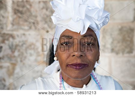 HAVANA,CUBA - JANUARY 20, 2014:Portrait of an afro woman dressed with typical clothes.Characters like this are common in Old Havana and a photo opportunity for the growing number of foreign tourists