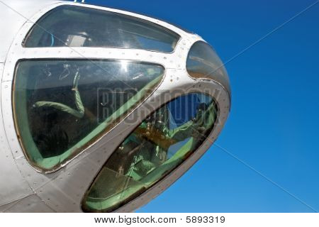 Front Of An Airplane With Blue Sky