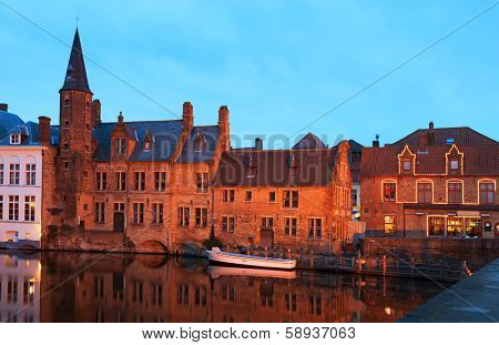 Romantic view on the channel in Brugge, Belgium. Bruges historic centre at Night. View from the Rozenhoedkaai.