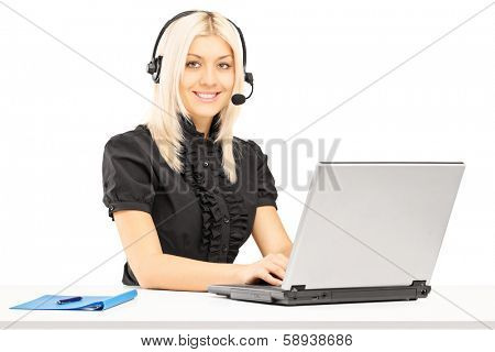 Young female customer service operator working on laptop, isolated on white background