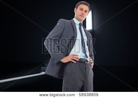 Stern businessman with hands on hips against door opening revealing light at top of steps