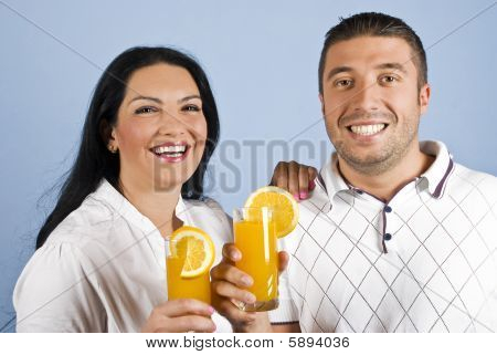 Laughing Healthy Couple With Oranges Juice