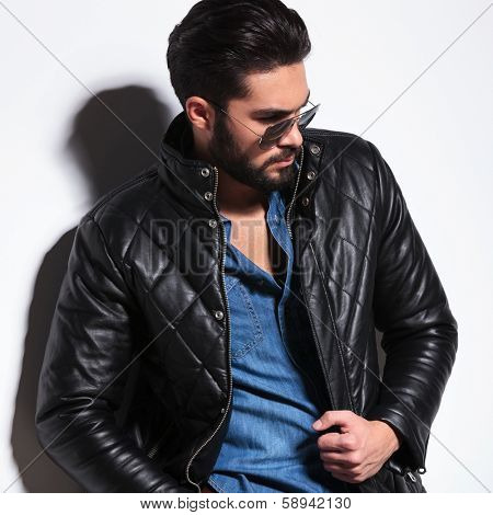 side view of a dramatic fashion male model posing in studio