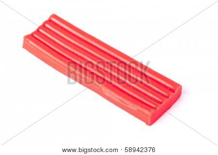 Single bar of plasticine isolated on whit background