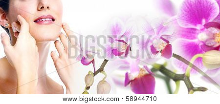 Young beautiful woman face with flowers collage.