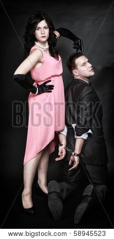 Attractive Couple Sexy Woman With Gun Gangster In Handcuffs