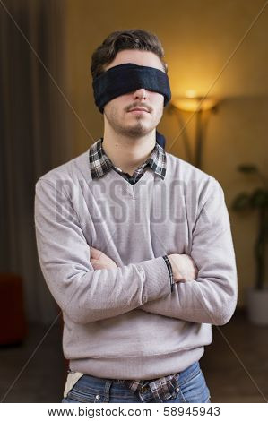 Blindfolded Young Man Cannot See