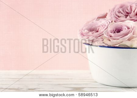 Pink Roses In A White Old Vase