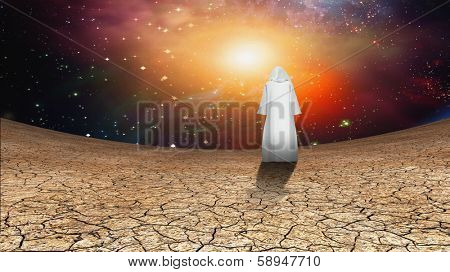 Desert and galactic sky with wandering cloaked figure